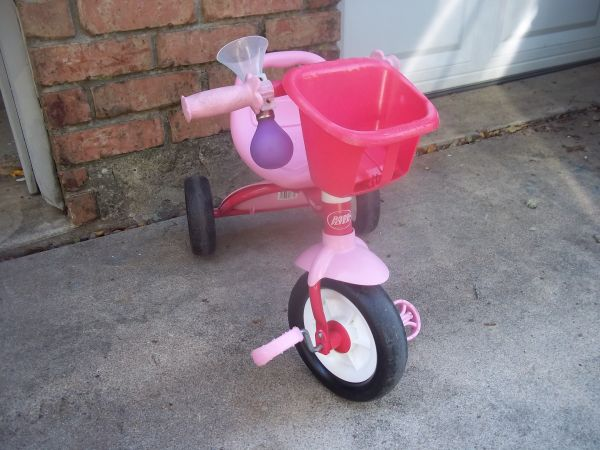 Radio Flyer Pink fold-n-go Tricylce with basket - $20 (West Columbia, TX)