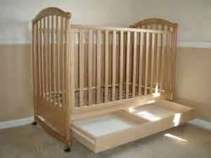 Light Wood Baby Crib with drawer underneath - $70 (SpringThe Woodlands Area)