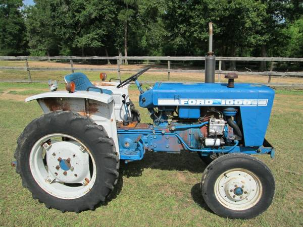 FORD 25 hp DIESEL TRACTOR w 5 ft BRUSH HOG  NEW 5 ft BOX BLADE - $3600 (cleveland)