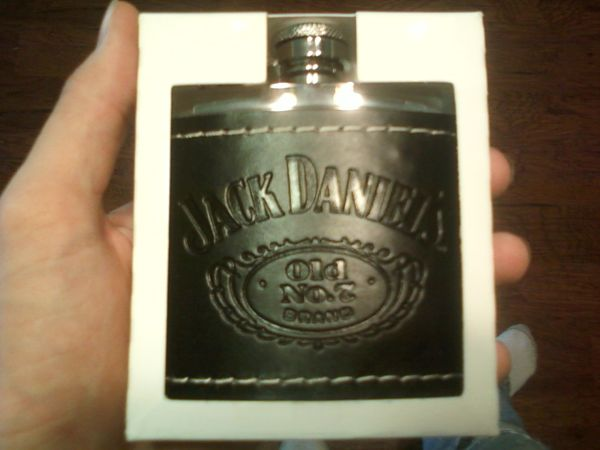 Jack Daniels whiskey flask leather wrapped - $20 (Willis, TX)