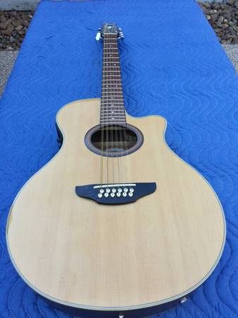YAMAHA 12 STRING ACOUSTIC ELECTRIC GUITAR 450$  - $450 (KATY TX )