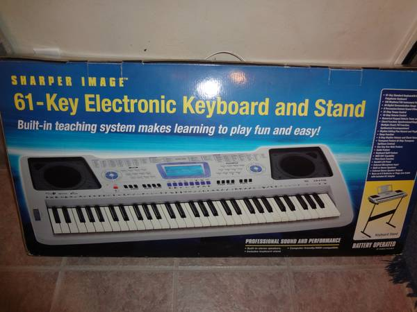 Sharper Image - 61 Key Electronic Keyboard with Stand - $100 (Spring Houston)