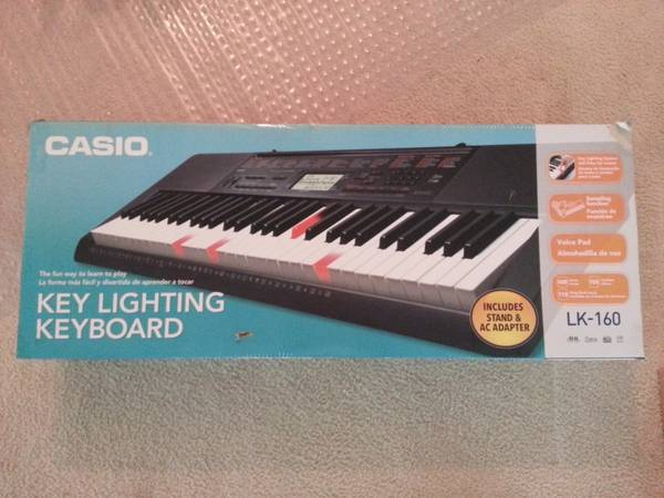 CASIO -- Key lighting keyboard with stand LK-160 - $100 (Spring TX)