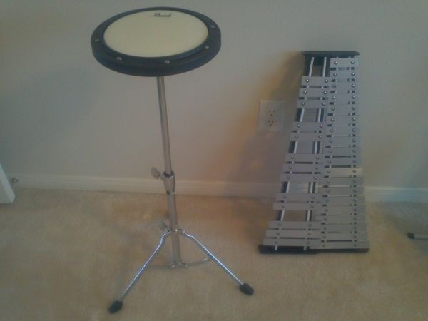Pearl percussion practice pad and bell kit - $200 (spring)