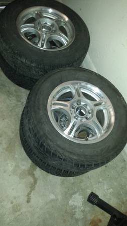 set of 14in 4 lug universal fit rims and tires - $140 (killeen)