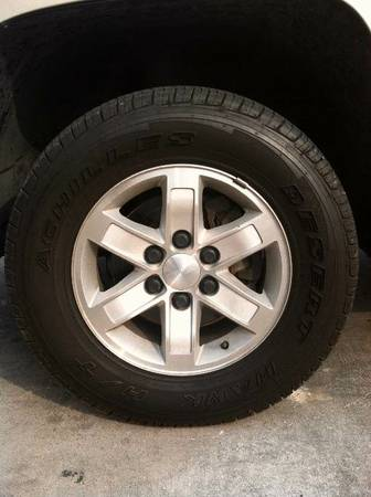 6 lug factory 17 inch chevy wheels and almost new tires - $575 (waco)