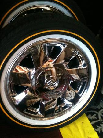 Cadillac chrome rims with vogue tires - $850 (Austin)