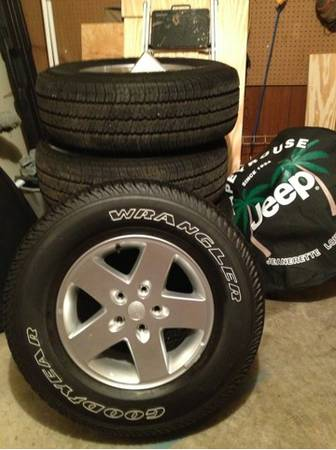 5 Jeep wrangler unlimited OEM wheels tires - $1200 (New Iberia)