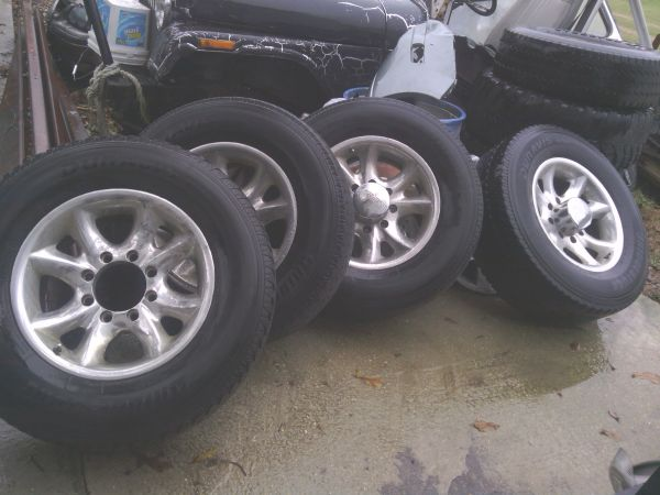Four 8-lug chevy tires and rims - $300 (Youngsville, La)