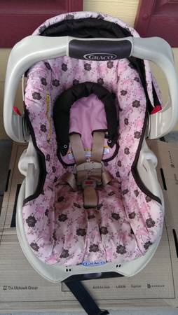 graco pink and brown infant car seat - $25 (opelousas)