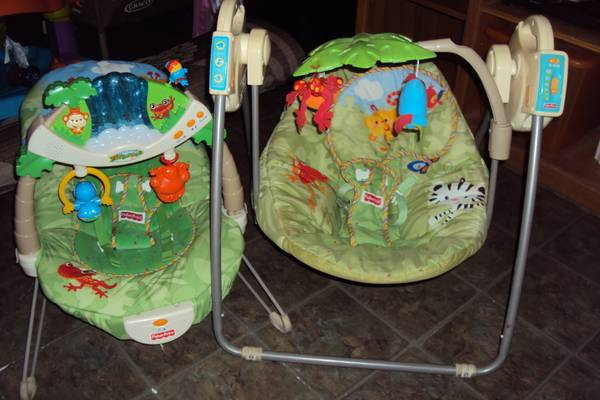 Fisher Price Rainforest Bouncer   Swing - $60 (Youngsville,La)