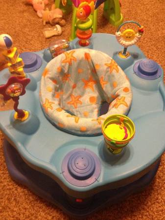 Various baby items ( exersaucer, boppy, sling, bottle rack) (Estherwood)