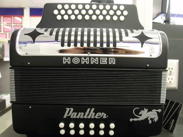 HOHNER PANTHER - $550 (1720 GUADALUPE ST)