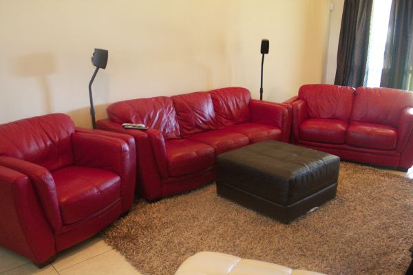 Red leather sofas from Lacks - $1200