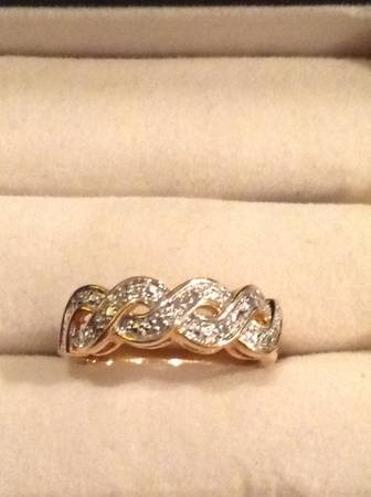 Stering silver ring covered in gold sise 8 -   x0024 40  San Juan Tx