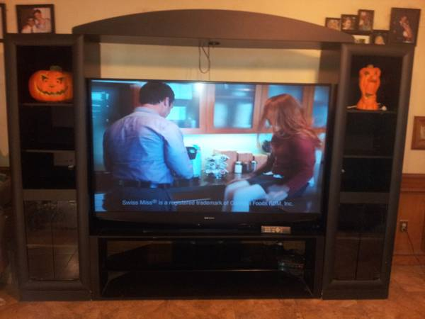 this green 73 inch Mitsubishi entertainment center - $2250 (rgv)