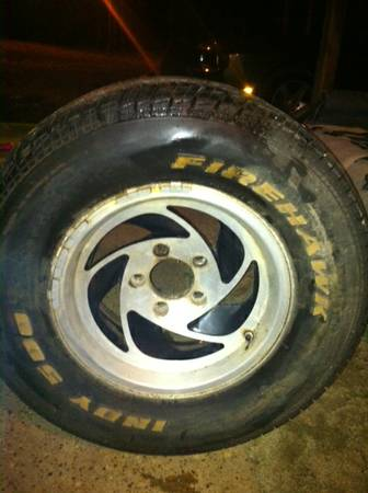4 chevy 15 inch rims and tires - $300