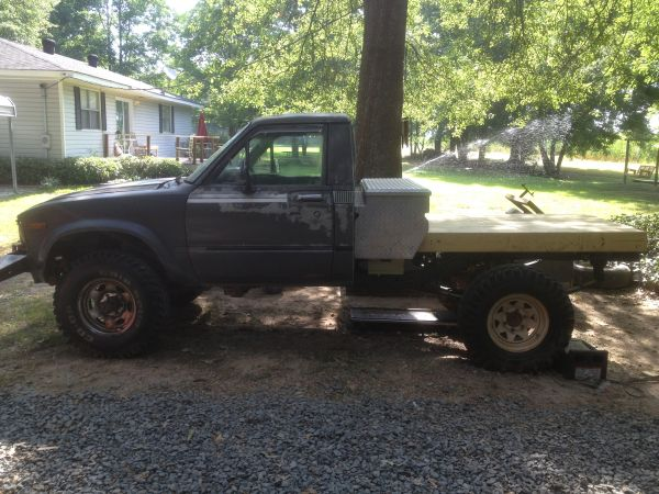 Toyota pickup 4x4 flatbed trade for boat - $2000 (monroe)