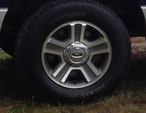 Stock f150 rims and tires - $1 (Nacogdoches)