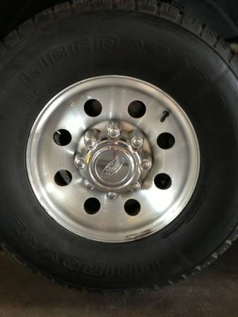 Ford 16 8 lug wheels and tires - $700 (Lufkin)