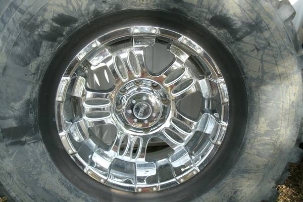 46inch military tires on 20inch chromeplated wheels - $1500 (kiln,ms)