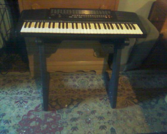 Electronic piano keyboard 61 key with stand - $55 ( Nacogdoches)