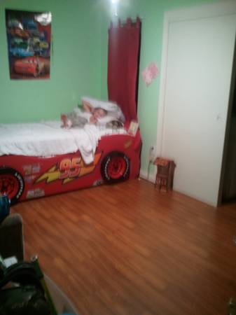 Boys twin car bed with trundle and two mattresses - $325 (Metairie)