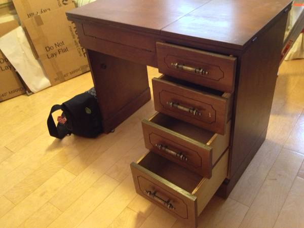 Parsons sewing machine cabinet - $45 (Lakeview)