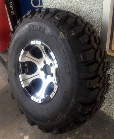 (SUPER SWAMPER) RIM  Tire - $150 (Johnson Tire Service)