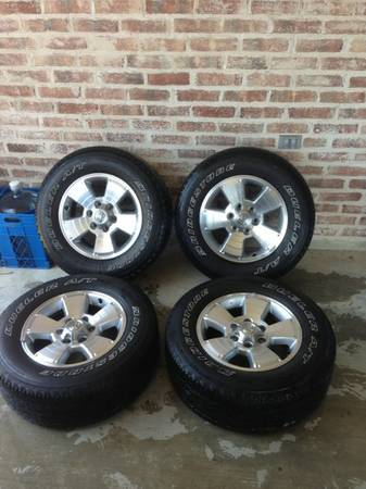 New Toyota Tacoma Sport rims and tires - $575 (Slidell)