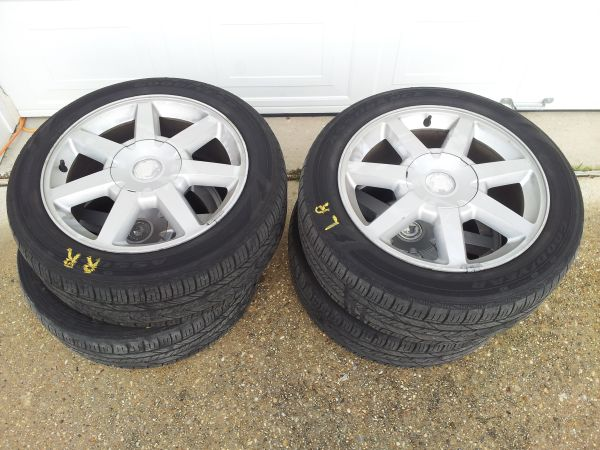 17 cadillac rims and tires - $250 (Slidell, LA)