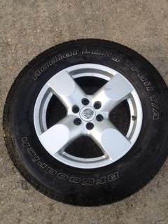 2008 Nissan frontier 4 OEM rims and tires - $600 (New Orleans )