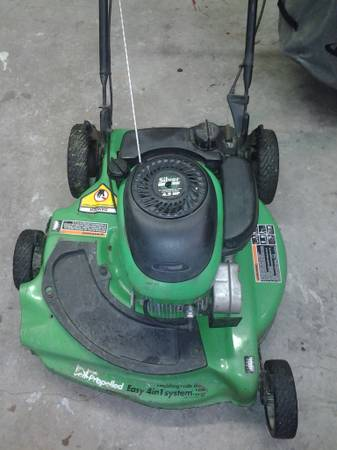 Classic Lawn boy with staggered wheel - $175 (westbank)