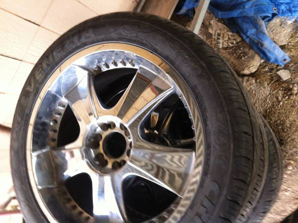 22 rims and tires - $900 (paint rock)