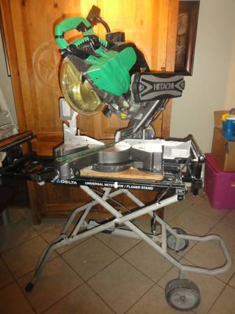 Hitachi compound miter saw on Delta universal stand - $600 (southside san antonio)
