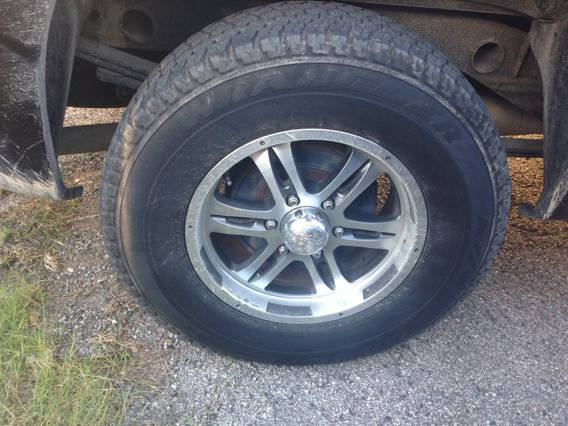 Looking to trade rims and tires and trailer for stock gmc Sierra rims and tires (Live oak)