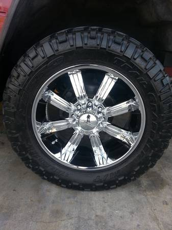 8 lug 37in mudd tires wrap on 22in rims nice cheap - $1500 (southside)