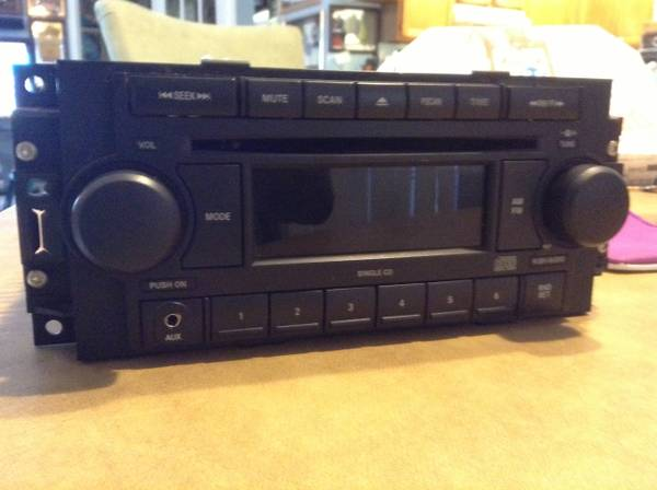 DODGE ( RADIO CD ) ( AUX ) IPOD,IPHONE,MP3,ZUNE FACTORY STOCK OEM - $85 (FITS DODGE,JEEP,CHRYSLER TRUCK CAR SUV)