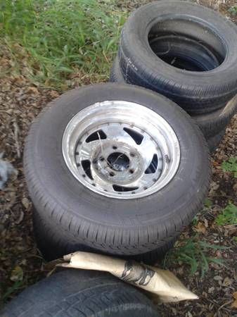 BRAND NEW 14 INCH TIRES ON CHEVY 5 LUG(CAR OR S10) RIMS $350 OR TRADE (1604 SOUTH BY 281 SOUTH)