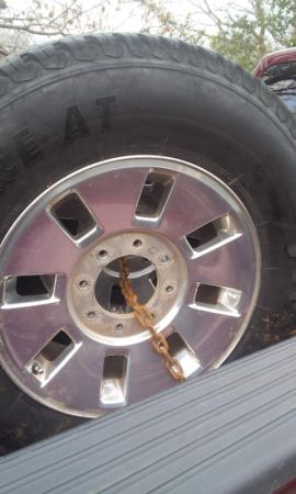 Ford 8 lug chrome wheels with firestone tires - $400 (kerrville)