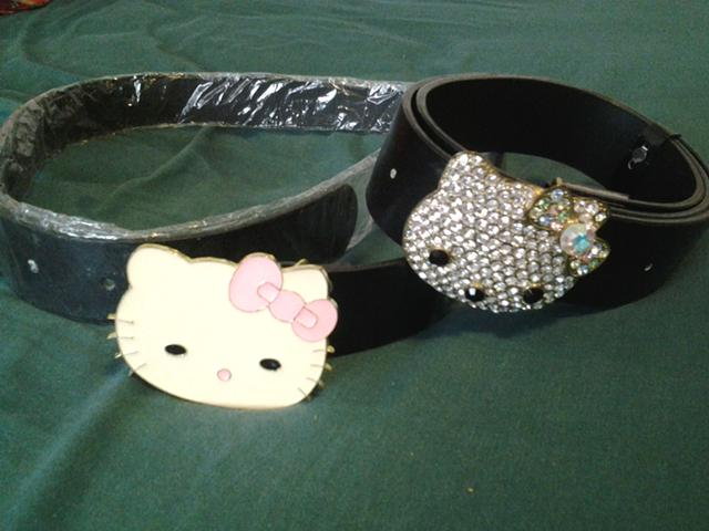 15  hello kitty belt buckles and jeans size 34