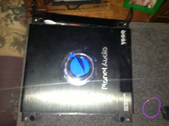 2 12 inch Punch Subs and 1500 watt Planet Audio Amp (35 and 90)