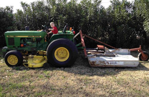 John Deere 750 Tractor with Belly Mower and 3 pt. Shredder - $6000 (Boerne)