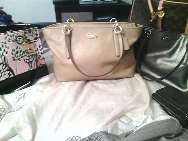 300  a leather tan coach bag 100 with papers