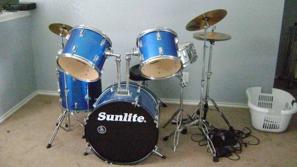 Sunlite Drum set with cymbals and stool. - $250 (Off Rigsby and 410)