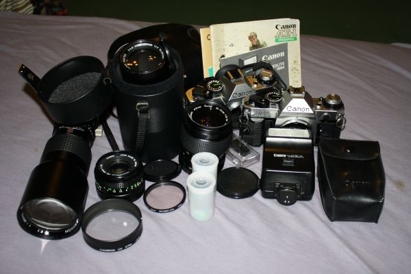 Canon AE-1, 4 lenses Accessories - $200 (Southeast (Rigsby 410))