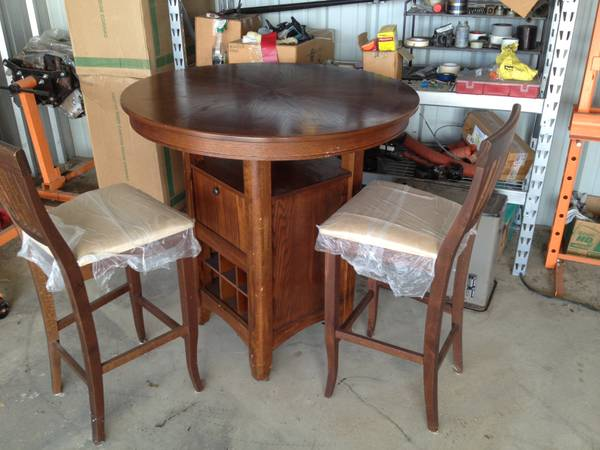 Pier One bar table and two chairs - $250 (McCarty and hunter rd)