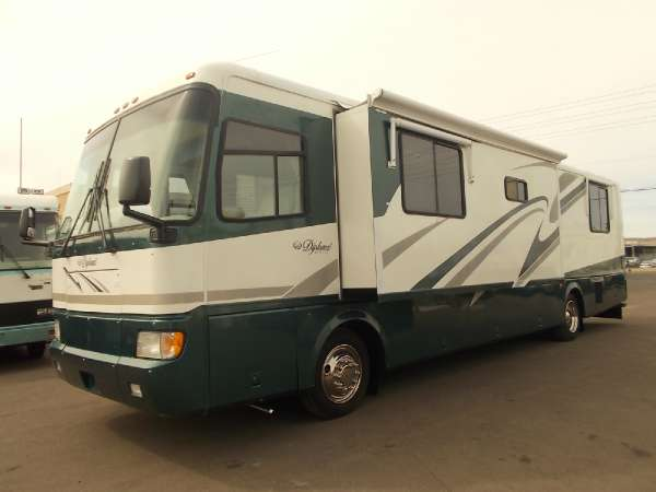 $29,900, Monaco Diplomat Diesel Slide Out Sleeps 4