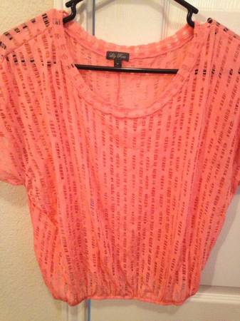 3 very cute womans size small blouses. - $10 (Dakota ranch)