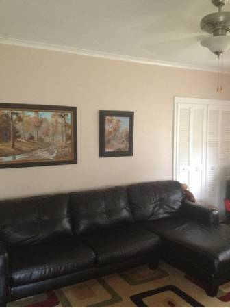 Black leather L shaped couch - $500 (Shreveport)